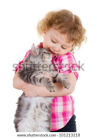 Little smiling girl holding a cat on white background