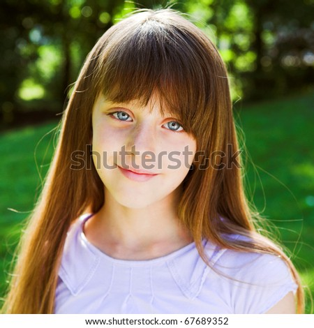Little smiling girl summer portrait - stock photo