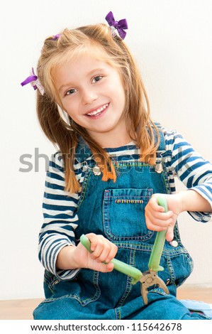 little smiling girl with old pliers