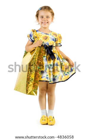 Little smiling girl with shopping bag. Isolate on white background.