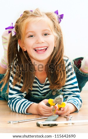 little smiling girl with tools