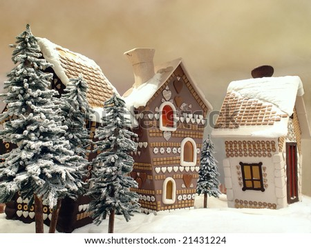 Little snow covered cottages made from gingerbread