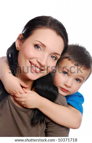 little son embracing his beautiful young mother