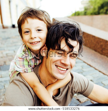 little son with father in city hagging and smiling, casual look  #518533276