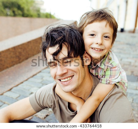 little son with father in city hagging and smiling, casual look outside playing, happy real family, lifestyle people concept #433764418