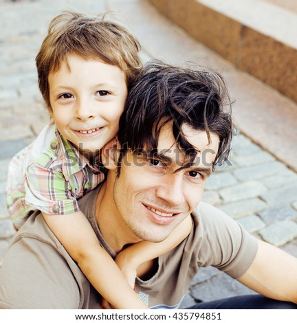 little son with father in city hugging and smiling, casual look outside playing, happy real family, lifestyle people concept #435794851
