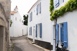 little street with white houses in France Ile de Noirmoutier