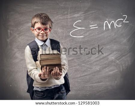 little student holding books