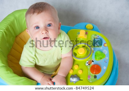 little sweet baby in the baby walker