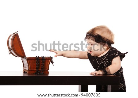 little sweet girl with jewelry - stock photo