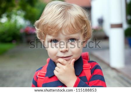 Little toddler boy on way to kindergarten outdoor