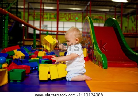 Little toddler child, boy playing in childrens playground indoors, kid plays  #1119124988