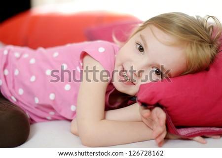 Little toddler girl in pajamas on sunny morning