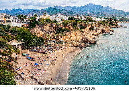 Shutterstock Little touristic town Nerja in Costa del Sol, Andalusia, Spain. It has many restaurants, bars and cafes. Aerial view of the beach