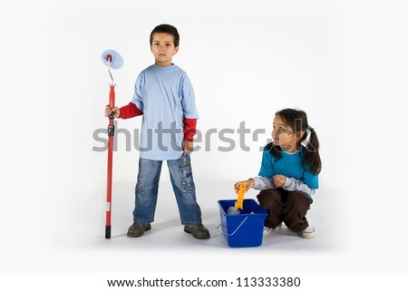 Little two workers with paint roller and blue pail isolated on white
