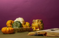 Little varicoloured pumpkins on a table, preparation to Хелоуину, available space for text, horizontal image