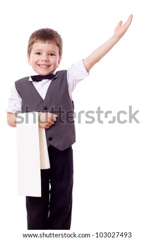 Little waiter standing with towel and pointing hand, isolated on white