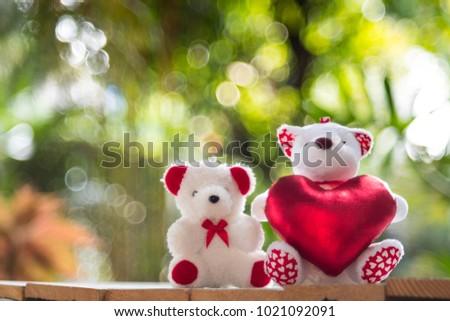 Little white bear hold red heart for valentine gift. #1021092091