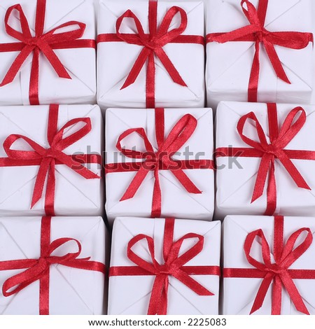 little white gifts with red ribbons