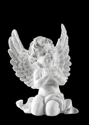 Little white guardian angel isolated on black background. Vintage style christmas decoration