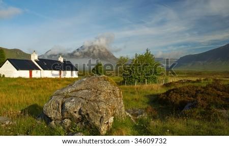 Little white house in Scottish highlands