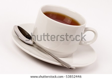 Little white tea cup isolated over grey gradient background