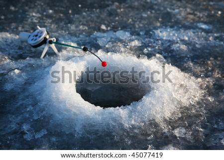 Little winter fishing rod in the hole