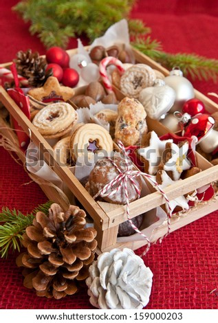 Little wooden box with a variety of cookies and nuts for christmas