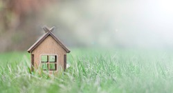 Little wooden house on the grass. Eco-friendly house concept. Real estate investment concept.