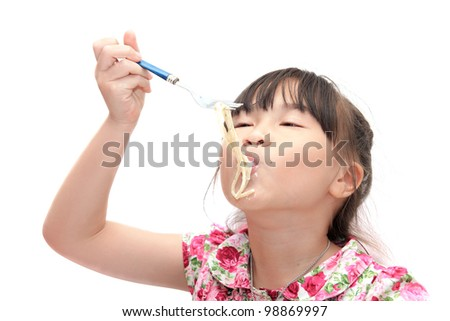 Little young girl eating pasta on white background