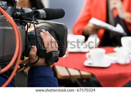 Live broadcasting, television operator with camera. Selective focus on hand #67570324
