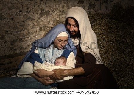 Live Christmas nativity scene in an old barn - Reenactment play with authentic costumes.