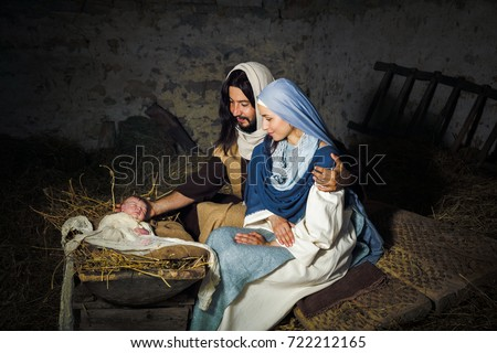 Live Christmas nativity scene in an old barn - Reenactment play with authentic costumes.  The baby is a (property released) doll. #722212165
