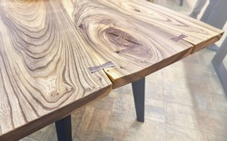 Live edge elm slab table with tree rings inner knot and bow tie joint close view