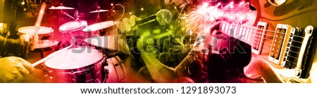 Live music and concert background. Guitarist and drummer and singer.Night entertainment and festival events.Musical performance on stage. Recreation and music show.