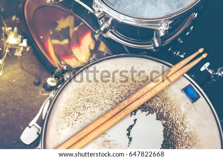 Live music background in vintage style.Drum kit on stage