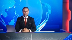 Live News Studio with Professional Male Newscaster Reporting on the Events of the Day. Broadcasting Channel with Presenter, Anchor Talking. Mock-up TV Newsroom Set with News Ticker.