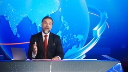 Live News Studio with Professional Male Newscaster Reporting on the Events of the Day. TV Broadcasting Channel with Presenter, Anchor Talking. Mock-up Television Channel Newsroom Set