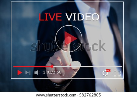 Live video,streaming concept.Business man press a play buttons #582762805