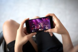 Live video streaming concept.Female hands holding mobile phone
