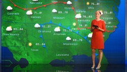 Live Weather News Studio with Professional Female On-Camera Meteorologist Standing Beside Screen and Making Gestures to Point at Weather Synoptic Map Chart for United States of America