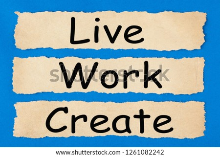 Live Work Create written in old torn paper on blue background. Business concept #1261082242