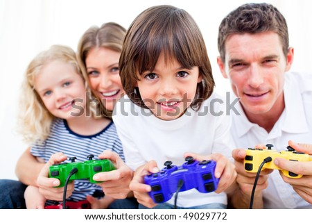 Lively family playing video game against a white background