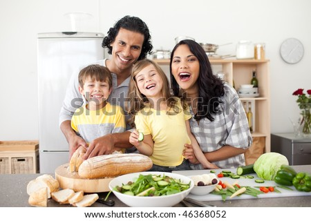 Lively family preparing lunch together in the kitchen