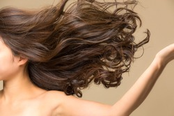 Lively hair on a beige background.