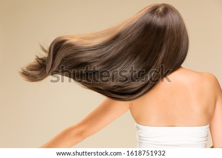 Lively hair on a beige background. Stockfoto ©