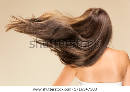 Lively hair on a beige background. Foto stock ©