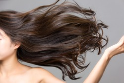Lively hair on a gray background.