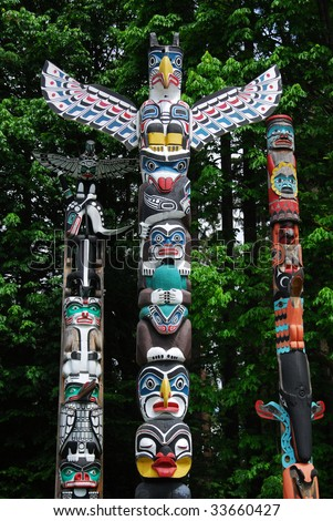 Lively historic totem poles by ancient native indian americans in the stanley park, Vancouver, British Columbia, Canada