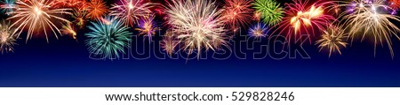 Lively multi-colored fireworks on dark blue background in panorama format, ideal for New Year or other celebration events #529828246